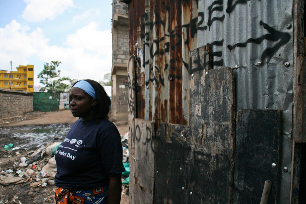 Tabitha taking a break following a community clean on World Toilet Day. Mathare 2010. Photo by: Sasha Turrentine