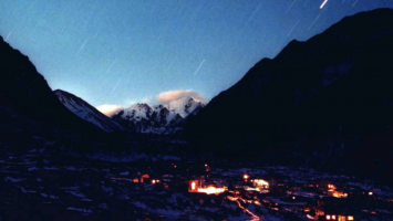 Figure 4. A photograph of the lights of Langtang village, taken shortly after the installation of the first micro-hydropower project in 1998 (K. Togami, The Tokyo Shimbun).