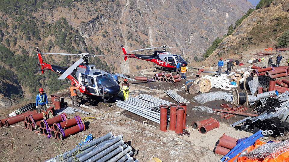Figure 6. Project materials being airlifted by helicopter to the project site at Kyangjin Gompa in November 2016 (Nima Lama).
