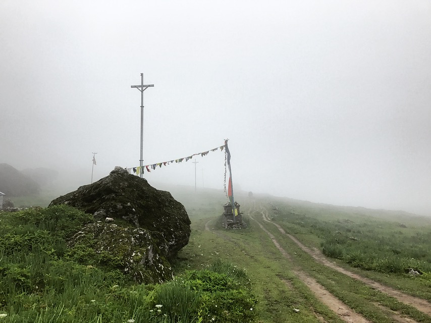 Figure 7. Transmission towers awaiting powerlines along the trail through the Langtang Valley in July 2017 (Austin Lord).