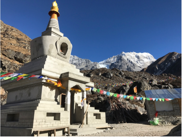 Figure 13. The Langtang Memorial Stupa, where water diverted for the micro-hydropower project is now flowing beneath this stupa, turning a large prayer wheel inside (Austin Lord).
