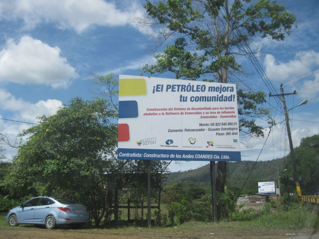 "State-sponsored billboards linked oil revenue to the improvement of urban life in Esmeraldas during electoral campaigns. The board reads, ""Oil improves your community,"" and states that neighborhoods affected by refinery activities also are benefitted by projects of water and sewage infrastructure sponsored by the national oil company."